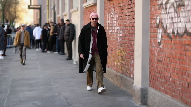 a guest is seen wearing khaki pants lumberjacket button shirt wool coat sneakers pink beanie during milan menswear fashion week autumn/winter 2019/20... - pink shirt stock videos and b-roll footage