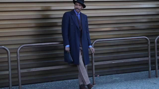 A guest is seen wearing navy wool coat hat brown pants blazer tie during the 95th Pitti Uomo at Fortezza Da Basso on January 10 2019 in Florence Italy