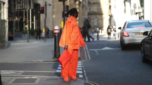a guest is seen wearing orange vest jumper sunglasses bag pants and sneaker outside edward crutchley during london fashion week men's january 2020 on... - weaving stock videos & royalty-free footage