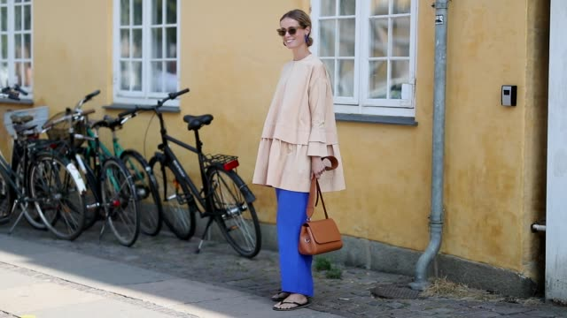 A guest is seen wearing pink top blue pants outside Lovechild during the Copenhagen Fashion Week Spring/Summer 2019 on August 9 2018 in Copenhagen...