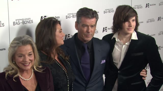 guest keely shaye smith pierce brosnan dylan thomas at premiere party for ae's original miniseries bag of bones on 12/8/11 in west hollywood ca - keely shaye smith and pierce brosnan stock videos & royalty-free footage