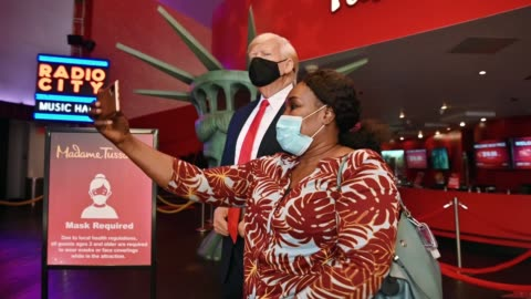 guest poses for pictures with a wax figure of u.s. president donald j. trump wearing a protective mask as madame tussaud's new york re-opens to the... - madame tussauds stock videos & royalty-free footage
