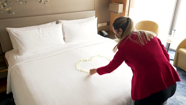 guest relations manager franziska frauscher creates a heart from rose petals in a room at the shangri-la hotel at the shard as it re-opens to the... - petal stock videos & royalty-free footage