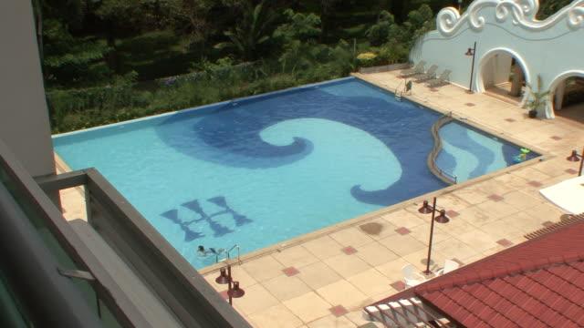 ms guest swimming at pool in luxury hotel / sihanoukville, cambodia - utebassäng bildbanksvideor och videomaterial från bakom kulisserna