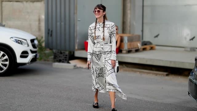 A guest wearing a dress outside Ganni is seen during the Copenhagen Fashion Week Spring/Summer 2019 on August 9 2018 in Copenhagen Denmark