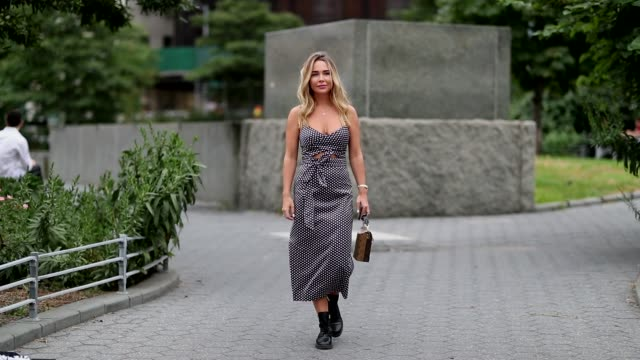 A guest wearing a grey dress boots during New York Fashion Week Spring Summer 2019 on September 07 2018 in New York City