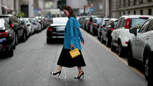 stockvideo's en b-roll-footage met guest wearing blue blazer jacket, black skirt seen outside salvatore ferragamo during milan fashion week spring/summer 2019 on september 22, 2018 in... - blazer