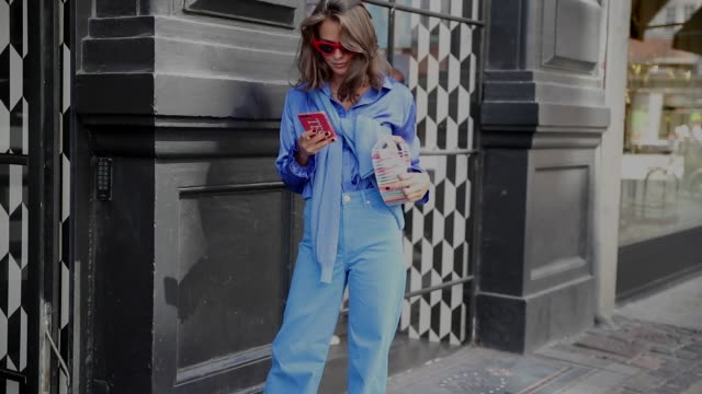 A guest wearing Del Rio London shoes 2ndday pants top and knit Cult Gaia bag Zara glasses during the Copenhagen Fashion Week Spring/Summer 2019 on...