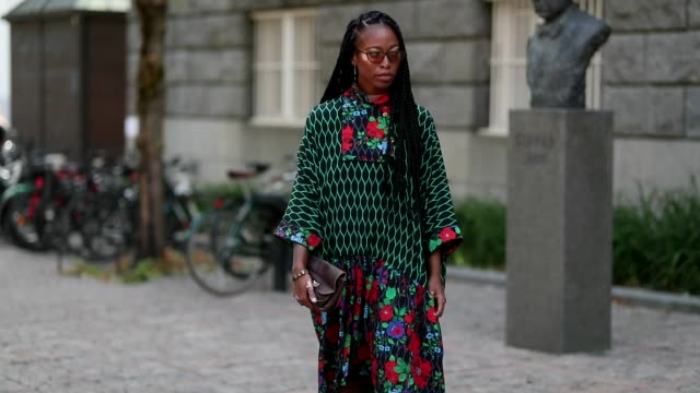 A guest wearing dress with floral print during Oslo Runway SS19 on August 14 2018 in Oslo Norway