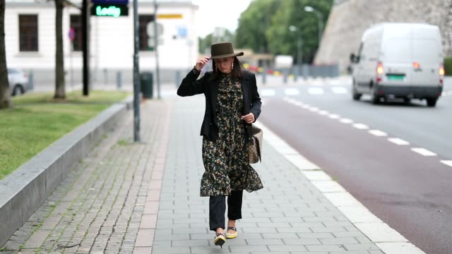 A guest wearing hat dress with print cropped pants and a black jacket is seen outside the Moire show during Oslo Runway SS19 on August 15 2018 in...