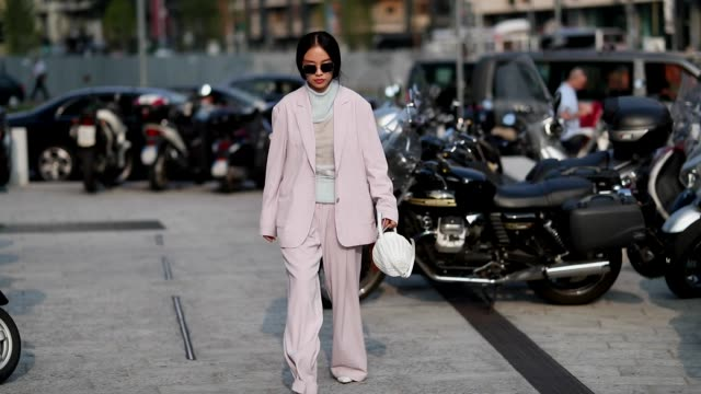 A guest wearing light pink suit white basket bag is seen outside Alberta Ferretti during Milan Fashion Week Spring/Summer 2019 on September 19 2018...