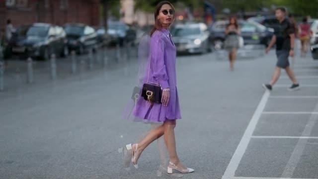 A guest wearing purple dress outside Saks Potts during the Copenhagen Fashion Week Spring/Summer 2019 on August 9 2018 in Copenhagen Denmark