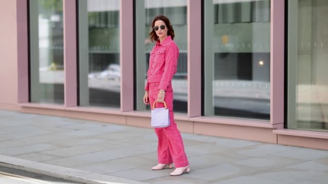 a guest wearing red corduroy pants and jacket is seen outside ports 1961 during london fashion week september 2018 on september 15 2018 in london... - completo video stock e b–roll