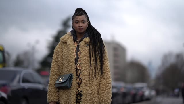 stockvideo's en b-roll-footage met a guest wears a bag black shoes a yellow fluffy long coat outside balmain during paris fashion week womenswear fall/winter 2019/2020 on march 01 2019... - week