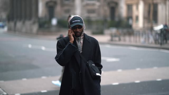 a guest wears a balenciaga cap a gingham hood a black coat sneakers during london fashion week men's january 2018 at on january 06 2018 in london... - gingham stock videos & royalty-free footage
