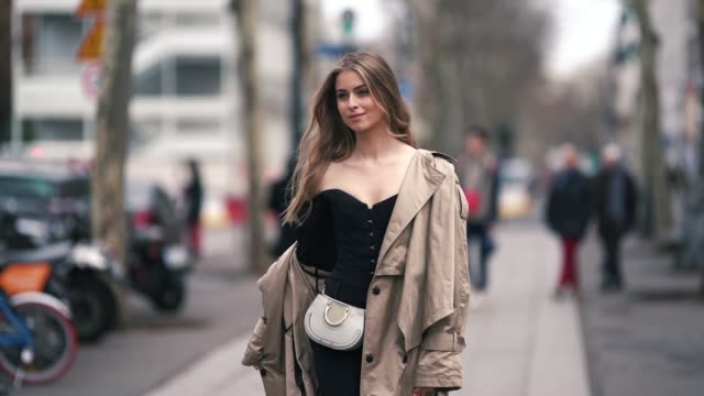 a guest wears a beige trench coat a black offshoulder top a white chloe bag outside altuzarra during paris fashion week womenswear fall/winter... - chloe designer label stock videos and b-roll footage
