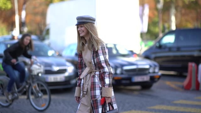 a guest wears a beret a tartan trench coat outside chanel during paris fashion week womenswear spring/summer 2018 on october 3 2017 in paris france - tartan video stock e b–roll
