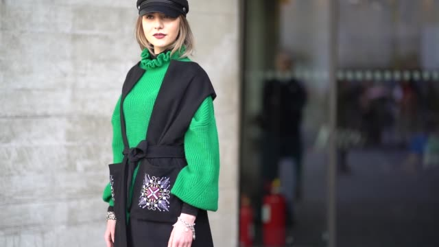 guest wears a beret hat, a green pull over, a black dress, green pants, a glitter bag, glitter shoes, during london fashion week february 2018 on... - black dress stock videos & royalty-free footage
