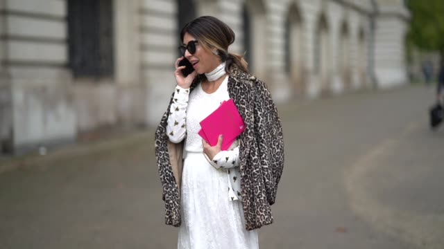 guest wears a beret hat, a white dress, a jacket, outside manish arora, during paris fashion week womenswear spring/summer 2018, on september 28,... - basco video stock e b–roll