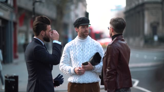 guest wears a beret hat, a white wool pull over, during london fashion week men's january 2018 at on january 06, 2018 in london, england . - basco video stock e b–roll
