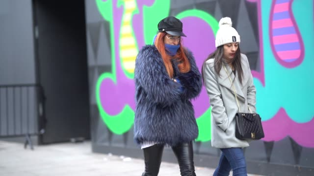 A guest wears a beret hat and a blue fur coat during London Fashion Week Men's January 2018 at on January 06 2018 in London England