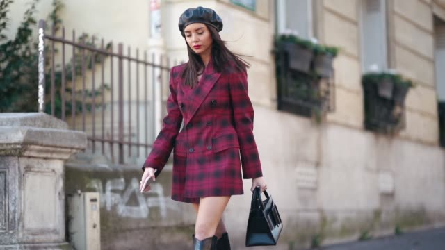guest wears a black beret hat, a red checked blazer jacket dress, a bag, black thigh high boots, outside dries van noten, during paris fashion week... - street style stock videos & royalty-free footage