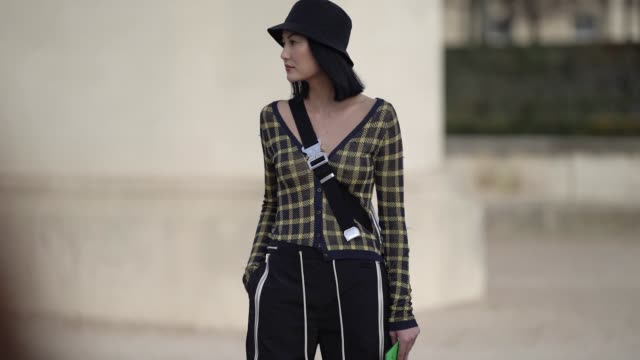 guest wears a black bob hat, yellow eyeshadow, a black and yellow checkered vest, black courrèges pants with sliding waist and zips on the side,... - vest stock videos & royalty-free footage