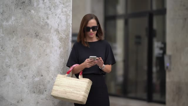 guest wears a black dress, black shoes, outside andrew gn, during paris fashion week womenswear spring/summer 2018, on september 29, 2017 in paris,... - black dress stock videos & royalty-free footage