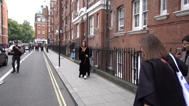 guest wears a black dress, outside jw anderson, during london fashion week september 2017 on september 16, 2017 in london, england. - black dress stock videos & royalty-free footage
