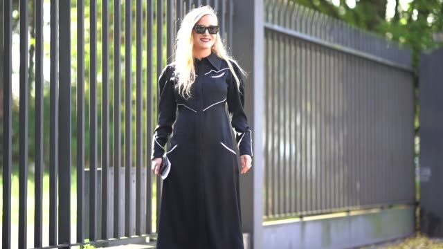 guest wears a black dress, sunglasses, floral print shoes outside cdg comme des garcons, during paris fashion week womenswear spring/summer 2018, on... - black dress stock videos & royalty-free footage