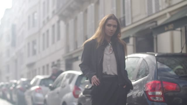 a guest wears a black jacket a white shirt and gray silk pants outside the valentino show during paris fashion week womenswear fall/winter 2017/2018... - white shirt stock videos & royalty-free footage