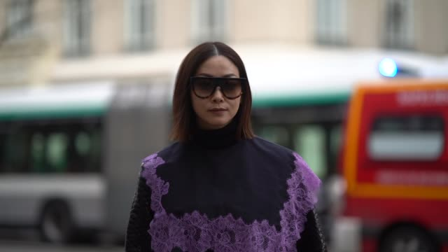 a guest wears a black leather dress a purple fishnet bag during paris fashion week womenswear fall/winter 2018/2019 on march 3 2018 in paris france - fishnet stock videos and b-roll footage