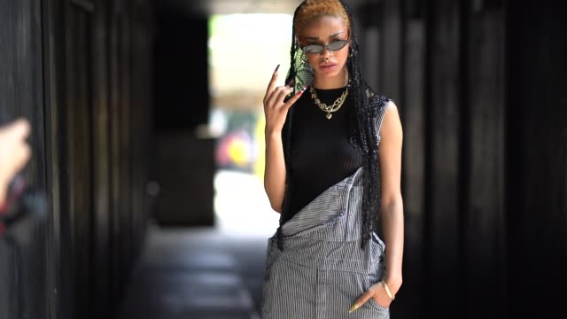 a guest wears a black tank top sunglasses a black and white striped jumpsuit black shoes during london fashion week men's june 2018 on june 10 2018... - jumpsuit stock videos & royalty-free footage