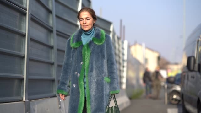 A guest wears a blue and green fur coat during Milan Menswear Fashion week Fall/Winter 2018/19 on January 14 2018 in Milan Italy