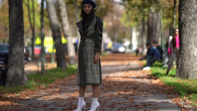 a guest wears a blue beret a tartan coat white shoes outside issey miyake during paris fashion week womenswear spring/summer 2018 on september 29... - tartan video stock e b–roll