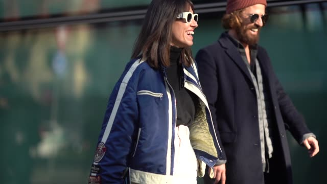 A guest wears a blue bomber jacket during Milan Menswear Fashion week Fall/Winter 2018/19 on January 13 2018 in Milan Italy