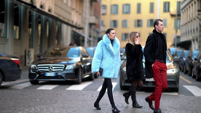 A guest wears a blue coat during Milan Menswear Fashion week Fall/Winter 2018/19 on January 14 2018 in Milan Italy