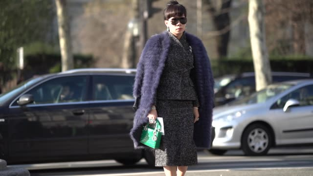 A guest wears a blue fluffy coat a green Lady Dior bag outside Dior during Paris Fashion Week Haute Couture Spring Summer 2020 on January 21 2019 in...