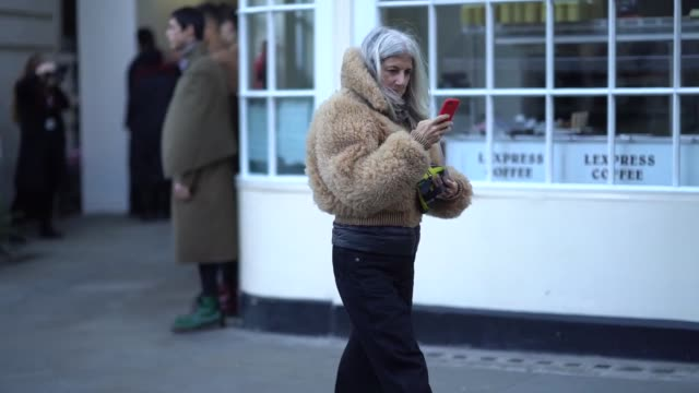 A guest wears a brown fur coat during London Fashion Week Men's January 2018 on January 07 2018 in London England