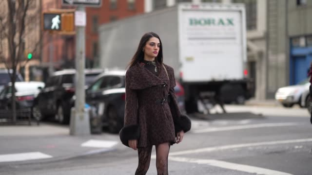 guest wears a brown jacket/dress with printed patterns and fluffy cuffs, mesh tights with embroidery, black leather pointy shoes, during new york... - tights stock videos & royalty-free footage