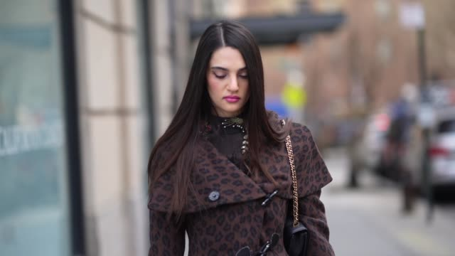 a guest wears a brown jacket/dress with printed patterns and fluffy cuffs mesh tights with embroidery black leather pointy shoes during new york... - tights stock videos & royalty-free footage