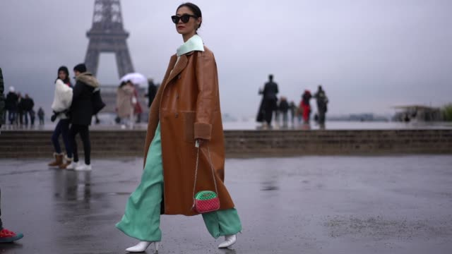 a guest wears a brown leather coat green flared pants a green and red bag during paris fashion week haute couture spring summer 2020 on january 23... - spring summer collection stock videos & royalty-free footage