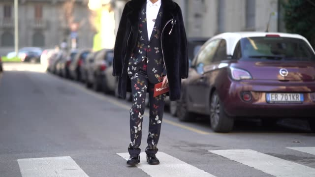 A guest wears a butterfly colored print blazer jacket and suit a coat during Milan Menswear Fashion week Fall/Winter 2018/19 on January 13 2018 in...