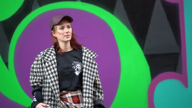 a guest wears a cap a checked coat a black top a checked skirt puma shoes during london fashion week men's january 2018 on january 07 2018 in london... - puma stock videos & royalty-free footage