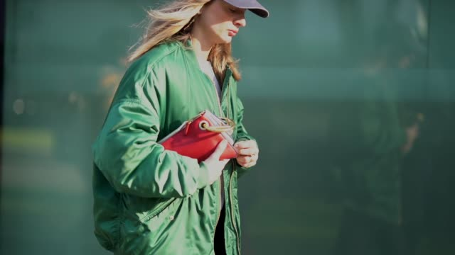 A guest wears a cap and a green bomber jacket during Milan Menswear Fashion week Fall/Winter 2018/19 on January 13 2018 in Milan Italy