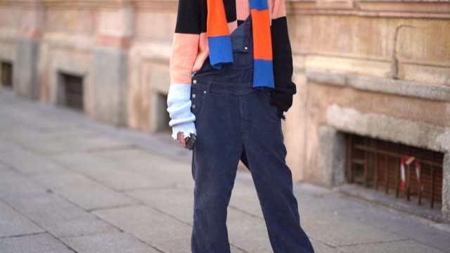 A guest wears a colored checked scarf during Milan Menswear Fashion week Fall/Winter 2018/19 on January 14 2018 in Milan Italy