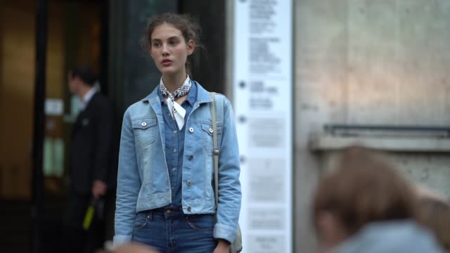 A guest wears a denim jacket outside Shiatzy Chen during Paris Fashion Week Womenswear Spring/Summer 2018 on October 2 2017 in Paris France