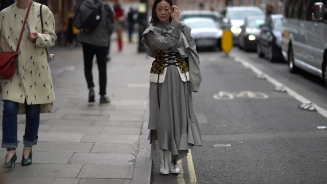 A guest wears a dress and a corset outside JW Anderson during London Fashion Week September 2017 on September 16 2017 in London England