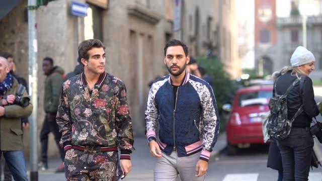 A guest wears a flower print bomber jacket a guest wears a bomber jacket outside Dolce Gabbana during Milan Menswear Fashion week Fall/Winter 2018/19...