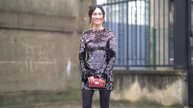 a guest wears a glitter dress a red bag black tights red shoes outside valentino during paris fashion week womenswear fall/winter 2018/2019 on march... - collant video stock e b–roll